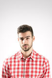 Portrait of skeptical young bearded man Stock Photo