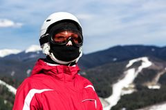 Skier standing on top of a mountain Royalty Free Stock Photo