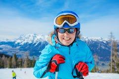 Portrait of skier woman enjoys the winter ski resort. royalty free stock photography