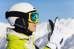 Portrait of skier woman with her ski over mountain Royalty Free Stock Images