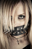 Portrait of a slave in BDSM theme. Gagged of thorns Royalty Free Stock Photography