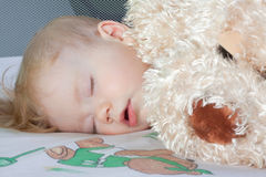 Portrait of a sleeping baby with a toy stock photos