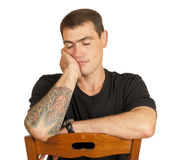 Portrait sleeping on a chair young men. Portrait sleeping on a chair young man isolated on white background Stock Photography