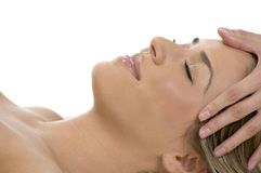 Portrait of sleeping female getting head massage Stock Photos