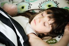 Portrait of sleeping little girl in bed Stock Images