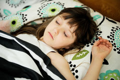 Portrait of sleeping little girl in bed Royalty Free Stock Photo