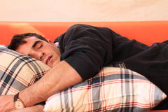 Portrait of sleeping man. Portrait of a sleeping young man with pillows Stock Photos