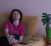 Portrait of sleeping middle age woman in pink shirt royalty free stock photo