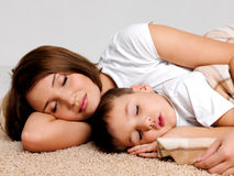 Portrait sleeping mother and the child Stock Photos