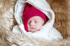 Portrait of sleeping newborn baby in warm winter clothes Royalty Free Stock Photos