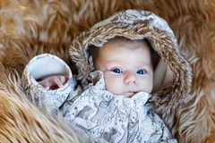 Portrait of sleeping newborn baby in warm winter clothes Stock Image