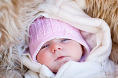 Portrait of sleeping newborn baby in warm winter clothes Royalty Free Stock Images