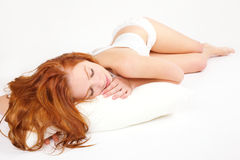 Portrait of sleeping woman with pillow Stock Photography