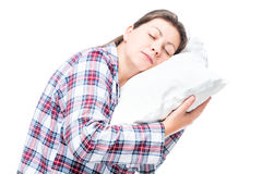 Portrait of a sleeping woman on a pillow on a white Royalty Free Stock Images