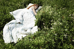 Portrait of the sleeping young woman on a meadow Stock Photo