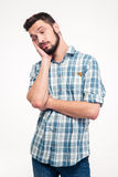 Portrait of sleepy tired handsome young man with beard standing Royalty Free Stock Photos