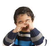 Portrait of a Sleepy Toddler Rubbing His Eyes. Isolated, white royalty free stock images