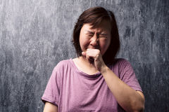 Portrait of sleepy young asian woman yawning. Stock Images