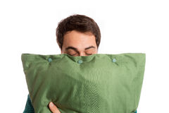 Portrait of a sleepyhead man in pajamas with its beloved pillow Stock Photography