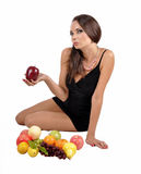 Portrait of slim fitness cheerful girl in studio with set of fruit and vegetables over white background. Healthy eating, diet, fit Stock Image