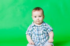 Portrait of a small baby boy, looking at the camera stock photo