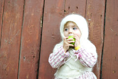 Portrait of the small beautiful girl. In a white scarf Royalty Free Stock Images