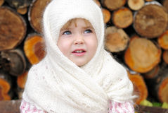 Portrait of the small beautiful girl. In a white scarf Stock Image