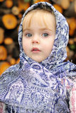 Portrait of the small beautiful girl. In a dark blue scarf Royalty Free Stock Photo