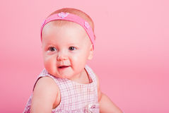 Portrait of the small beautiful joyful girl Royalty Free Stock Image