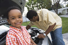 Portrait Of A Small Boy Sitting On Car Royalty Free Stock Photos