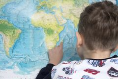 Portrait of small boy studying the map of the world Royalty Free Stock Photos