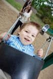 Portrait of Small Boy Swinging Royalty Free Stock Images