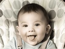 Portrait of small caucasian baby boy sitting at the chear Royalty Free Stock Images