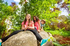Portrait of small children group sitting on stone Royalty Free Stock Photos