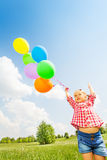 Portrait of small cute girl with many balloons Royalty Free Stock Images