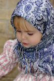 Portrait of the small girl in a blue scarf Royalty Free Stock Images