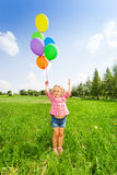 Portrait of small girl with colorful balloons Stock Image