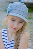 Portrait of small girl in denim cap outdoors Royalty Free Stock Image