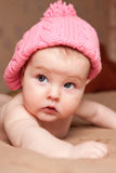 Portrait of small girl in a pink hat Stock Images