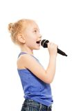 Portrait of small girl singing in microphone Royalty Free Stock Photo
