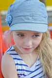Portrait of small girl in striped clothes outdoors Royalty Free Stock Photos