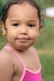 Portrait of a Small Girl in a Swimsuit. A closeup of a wet playful toddler girl Royalty Free Stock Photography