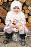 Portrait of the small girl in a white kerchief Royalty Free Stock Photo