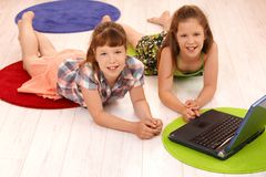 Portrait of small girls with computer Royalty Free Stock Photography