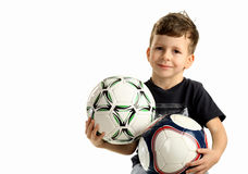 Portrait of small happy boy with two ball Royalty Free Stock Image