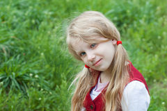 Portrait of the small pensive girl outdoors Stock Images