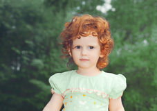Portrait small redhaired girl Royalty Free Stock Photo