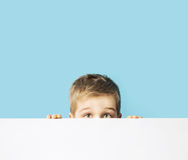 Portrait of the small shy boy Stock Images