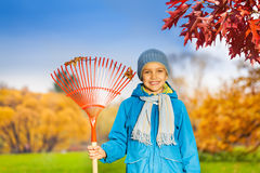 Portrait of small smiling boy with rake in park Stock Photography