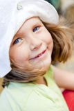 Portrait of small smiling girl. Closeup of smiling small girl in hat Royalty Free Stock Photos